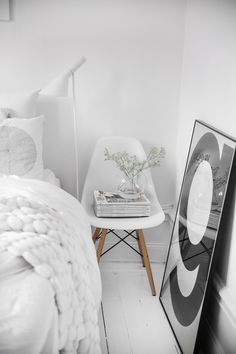 I LOVE chairs like this but they aren't the comfiest... Good idea to incorporate it into a room as a bed side table
