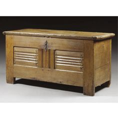 A BOARDED CHEST, BRUGES, 16TH CENTURY oak, the boarded top above a twin panelled front with horizontal linenfold carving  h.75cm., w.147cm., d.62cm.