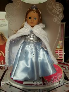 wow! now that is what I call a super nice doll dress! reminds me of the dress on one of the characters that is in new movie frozen that is coming out this november.