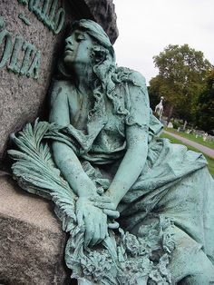 Mourning green woman statue in Greenwood Cemetery in NY #sculptures