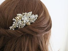 This vintage inspired bridal hair comb features gold and silver color palette, ivory pearls, rhinestone, crystal flower details...  The style of this gorgeous wedding headpiece is that can be worn from day to night, and occasions beyond the wedding day. Something a little different and unexpected  Measurement* 2.5 x 3.5 at the widest point  ................................  SukranJewelry designs are premium quality costume jewelry All my pieces are handcrafted in my home studio in Tampa, FL…