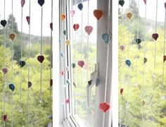 "Sandra's ""falling rain"" window dressing - imagine with felt raindrops coming from crochet clouds at the top!"