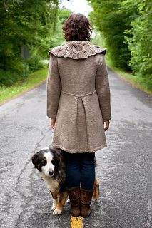 """A great coat for cold weather. The body of the shaped coat is kept simple in St st with seed stitch edges. The back has a inverted box pleat to add extra interest. The stunning collar is designed to stand out in a bold texture and a reversible cable, and it can be worn a number of ways. Issara is intended to be worn with a 3 ½–4 ½"""" / 9–11.5 cm positive ease to accommodate bulkier cold-weather clothing. Because it's worked in bulky yarn, it will knit up relatively fast for a coat."""