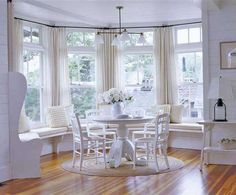 Love all the windows, the window seating, and the light and bright colors