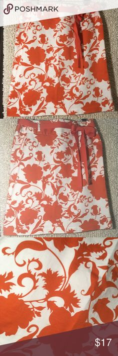 """Cute and comfy summer skirt Orange and white stretch skirt with solid orange ribbon belt. Ties on the side, in front or back! In great condition. Zipper and clasp in back, no slit. 20 3/4"""" long. Uniform-John Paul Richards Skirts Pencil"""