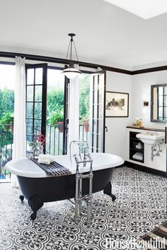 black + white bathroom with medallion pattern tile floor