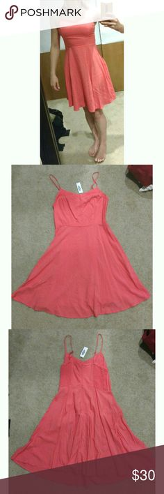 NWT Coral Pink/Orange Rayon Sundress Small NWT Old Navy Coral Pink/Orange Size Small Really cute fit. Small stain on bottom front, since it is NWT I assume it will wash out Old Navy Dresses Mini