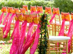 Google Image Result for http://www.achampagnewish.com/wp-content/uploads/2010/10/CWCeremonyOrangeandPinksashesonchairs.jpg