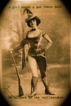 A Girl Needs a Gun Vintage Photo via Etsy.