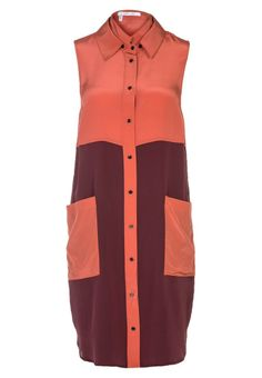 Orange dress with noraml fitting and turn down collar and 100% silk.