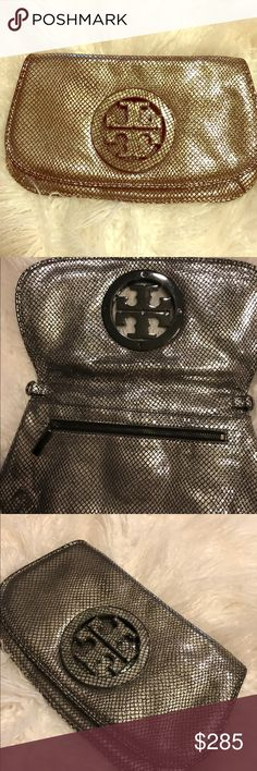 Silver Tory Burch Clutch 100% authentic a silver, in perfect condition Tory Burch clutch. Does not come with strap. Tory Burch Bags