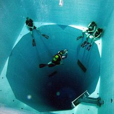 The world's deepest swimming hole, located in Brussels, Belgium. Nemo 33 is a submerged structure with platforms at various levels that plummet down 108 feet! It holds 2,500,000 liters of non-chlorinated spring water that stays a toasty 86 degrees. Divers often use this facility to train, and there are even simulated underwater caves! All-out awesome!