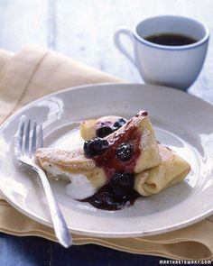 Blueberry Blintzes Recipe. These paper-thin crepes can be filled with just about anything. For this rendition, a handful of blueberries is blended into a velvety mixture that's spooned into golden, delicate pancakes.