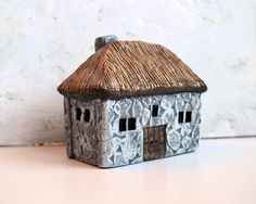 """Handmade polymer clay fairy house...fairy houses...fairy gardens...Old Stone English Cottage House with thatched roof  $56  You will receive the exact house in the picture.  This house would look perfect in a fairy garden surrounded by tiny plants, ferns, succulents or ivy. You can construct a tiny stone path leading up to it too. This house is 3"""" tall, 3 1/4"""" wide and 2 1/4"""" deep."""