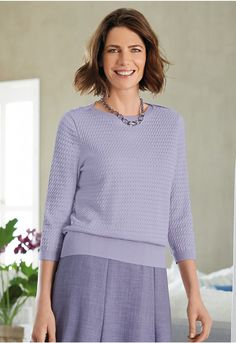 Made in a soft cotton and wool-blend yarn, our attractive pointelle and transfer stitch top has three-quarter sleeves and is finished with rib hems and a ribbed neck and shoulder detail with button trims. Jumpers For Women, Wool Blend, Tunic Tops, Classy, January 10, Pullover, Texture, Knitting, Sleeves