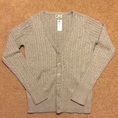 Girls 12 NWT gray uniform approved v neck sweater Girls NWT gray uniform approved v neck sweater from 77 kids (American Eagle) size 12. 77 kids Sweaters Cardigans