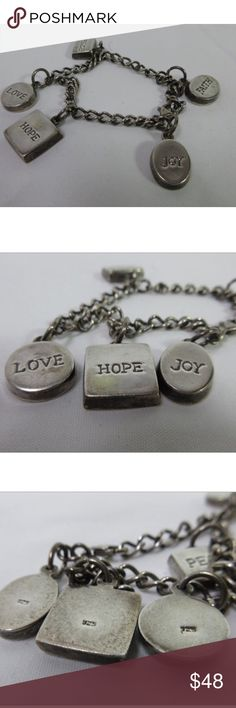 """925 Sterling Silver Inspirational Charm Bracelet Meaningful words inspire you throughout your day every time you glance at your wrist and see the words - JOY - HOPE - LOVE - PEACE - FAITH - These 5 charms have the 925 Sterling Silver hallmark. The bracelet itself is also marked. Total length of the chain bracelet is 7.5"""". Total weight of this bracelet is 15.33 grams. Given as a gift it is sure to be treasured. I have purposely not removed the patina knowing some people prefer the look of…"""