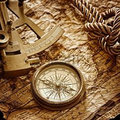 vintage  still life with compass,sextant and old map photo