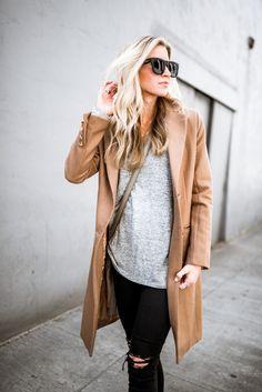 Camel coat + black pants + Adidas sneakers