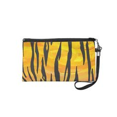 Black and Orange Tiger Print Wristlet Clutches created by ITD Wild Me. Go wild with this trendy and stylish animal print design with a unique touch of texture and pizzazz. www.zazzle.com/itdwildme*
