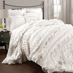 Add feminine-chic flair to your master suite or guest bedroom with this classic comforter set, showcasing layers of ruffled detailing in a crisp white hue.