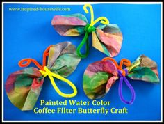 Painted Water Color Coffee Filter Butterfly Craft. I used it for the Monarch Migration game.
