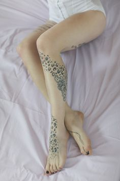Beautiful feminine leg tattoo