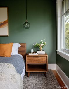 Benjamin Moore's Cushing Green gives this principal bedroom a cocoon feeling and pairs perfectly with warm wood accents for a fresh spin on mid-century modern design. Bedroom Green, Green Rooms, Forest Green Bedrooms, Olive Bedroom, Coin Banquette, Mid Century Modern Bedroom, Mid Century Modern Design, Mid Century Interior Design, Mid Century Modern Table