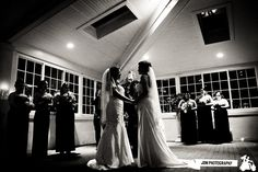 Jen + Alyson's beautiful wedding ceremony in the Atrium of the Grand Ballroom.