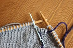 Underarm Divide Part 1.  For top down raglans. Learn how to put sleeve stitches on scrap yarn and connect the body.  See Part 2.