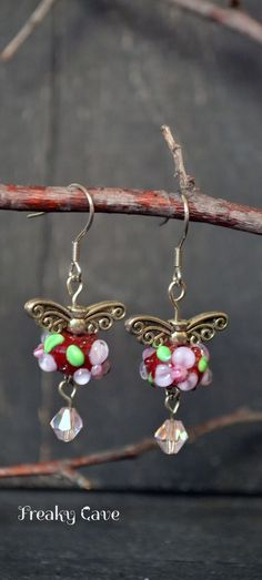 Tiny red and pink flower earrings with artisan lampwork beads by Freaky Cave - get them on Etsy ♥