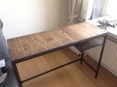 We found this very cheap VITTSJO laptop table and upgraded it with reclaimed french oak and two coats of ebony oil stain.