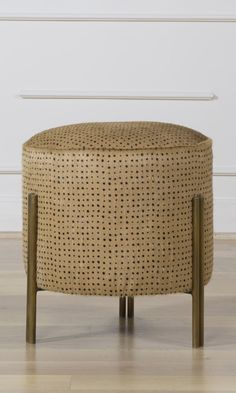 KELLY WEARSTLER   MELANGE FOOT STOOL. Low seating ottoman with burnished brass legs