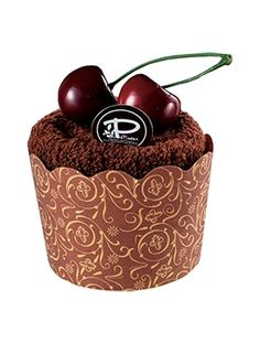 Le Patissier Chocolate cupcake shape designer towel with a topping of strawberry magnet available for AED 21 only..
