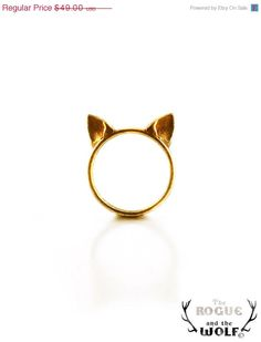 Gold cat ears ring.