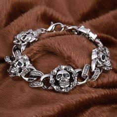 Gothic Skull Charm Bracelet - Skullflow    https://www.skullflow.com/collections/skull-bracelets/products/gothic-skull-charm-bracelet