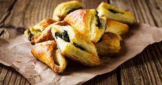 Vegetarian Spinach And Cheese Triangles Are Perfect For A PartyThe Healthy Mummy Spinach Puff, Spinach And Cheese, Creamy Cheese, Baby Spinach, Frozen Spinach, 200 Calories, Cheese Triangles, Wine Recipes, Feta