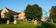 3Steps | The Sense of Things | Germany | Kleinsassen | blue | yellow | pink | girl | brush | lion | mural | graffiti | urban | Art | sky | nature | plane |  hands | patterns | eagle