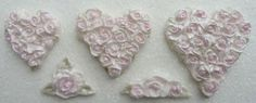 Piped Rose Hearts Silicone Mould by Karen Davies. Mould includes 3 x hearts (42mm long x 40mm wide, 50mm x 50mm, 65mm x 60mm), single rose with 3 leaves (37mm x 30mm), triple rose and leaf (50mm long x 15mm wide)