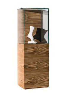 A nice bright LED overhead and you've got a museum quality display! [NEST   Floor-standing retail display case - SOVET ITALIA] www.shoparchiproducts.com