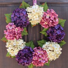 Spring / Easter Wreath with Purple, Cream & Pink Faux Hydrangeas. This colorful wreath would look great on your front door for the Easter holiday, as well as the spring and summer seasons. The wreath is handmade to order using a grapevine wreath base with silk rose pink, cream and purple hydrangeas, and is available in your choice of the following approximate sizes (measured outside leaf tip to tip): 6 hydrangeas ( 16-17 inches ) 9 hydrangeas ( 23-24 inches ) ( Shown) 12 hydrangeas (…