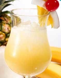 Antiguan Smile Cocktail  Straight from Abracadabras in Antigua, this fruity tropical drink is the perfect blend of rum, banana, pineapple with a dash of magic!    SERVES one    2 oz. white rum  1 oz. crème de banane  4 oz. fresh pineapple juice    1. Combine ingredients in a shaker; pour into a 9-ounce glass over ice. Garnish with a pineapple or orange wedge, cherry and coconut.