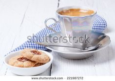 Coffee cup and cookies on a white vintage background.