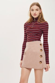 Invest in cord this season with this pale pink cord asymmetric wrap mini skirt with button detailing. Team with a funnel neck top for a cute retro look.