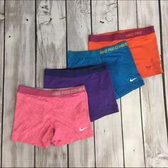 Nike Pro Bundle All have been worn - pictures show wear. Pink, purple, blue, and orange Nike Shorts