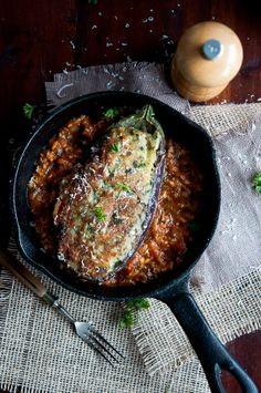Cheese stuffed eggplants in hearty tomato sauce