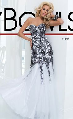 Strapless illusion and lace gown with a dropped waist and lace accents by Tony Bowls Le Gala.