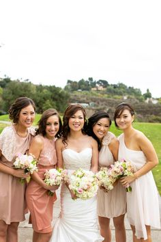 I like the idea of all the bridesmaids wearing different dresses of the same color, saves money and allows everyone to be comfortable and unique