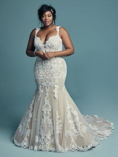 This elegant fitted gown features lace appliques and crosshatching detail, paired with a sweetheart neckline, scoop back and a lace accented train.