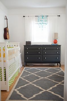 Baby boy nursey by oatmeal lace design. Love the carpet